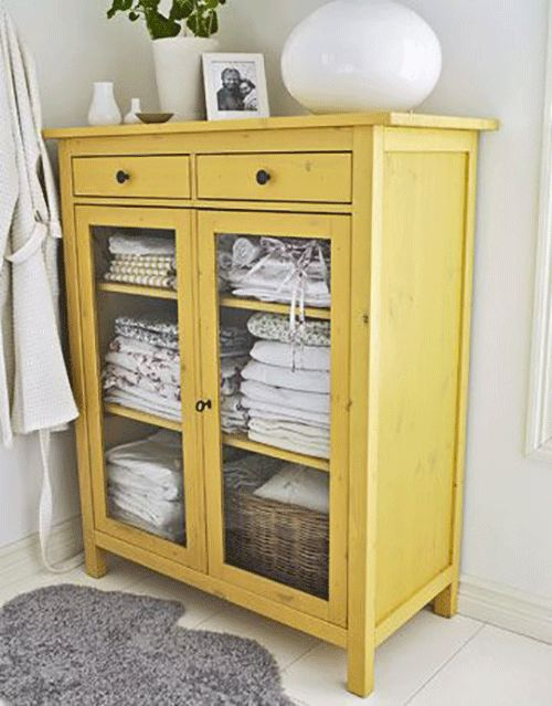 yellow hutch in the bathroom - storage for towels, sheets, etc.