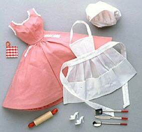 Vintage Barbie Q Ensemble (1959-1962): Backyard BBQ ensemble includes Rose Cotton Sundress, White Apron, White Chef's Hat, Knife with Red Handle, Spatula with Red Handle, Spoon with Red Handle, Wooden Rolling Pin, Potholder