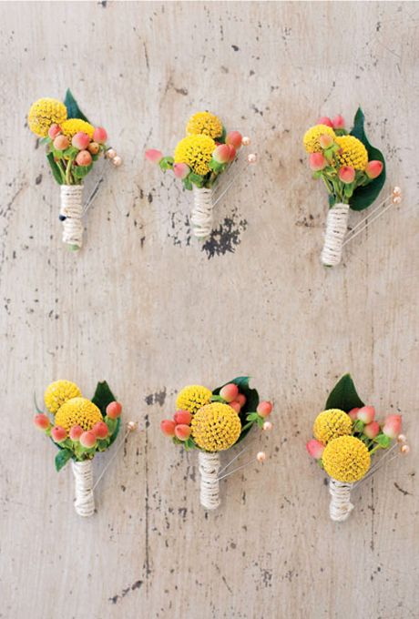 Wedding boutonnieres of yellow billy balls, peach hypericums, and coffee berries, wrapped with twine. love that there is coffee beans there <3