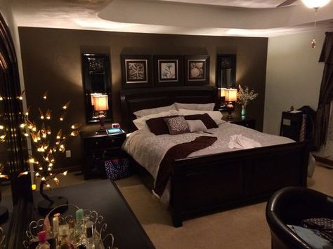 Elegant bedroom. Chocolate brown accent wall, sage color walls, dark brown furnitures