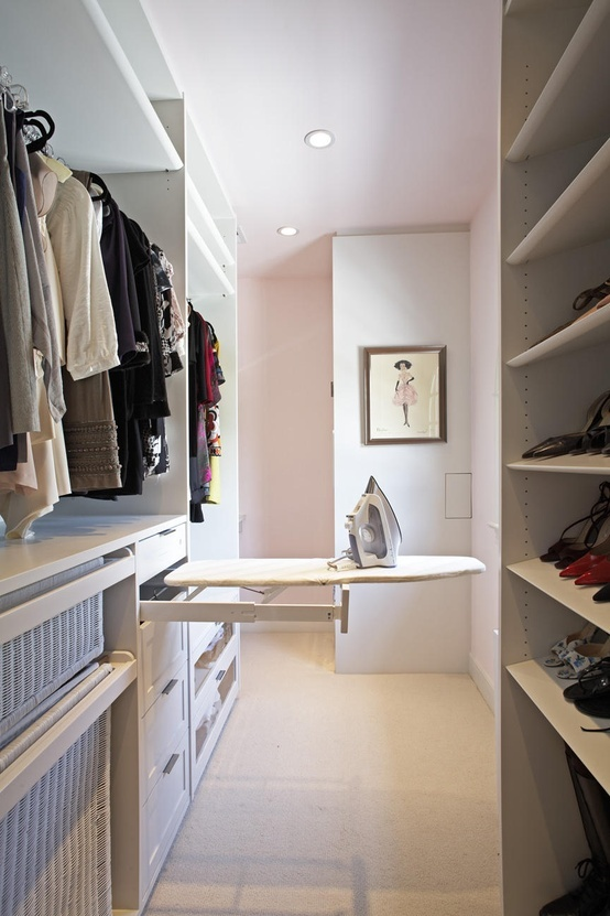 Very smart to include a mini ironing board in the closet.