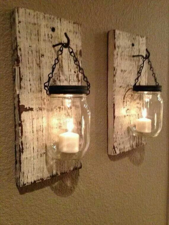 Mason jars having from a slat if wood. Perfect for patio decorated in whatever colors you would like!