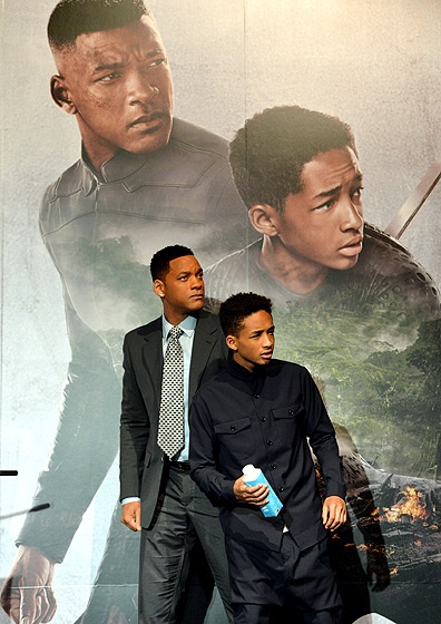 Will Smith and Jaden Smith mimicked their poster at a press conference for their new movie, After Earth