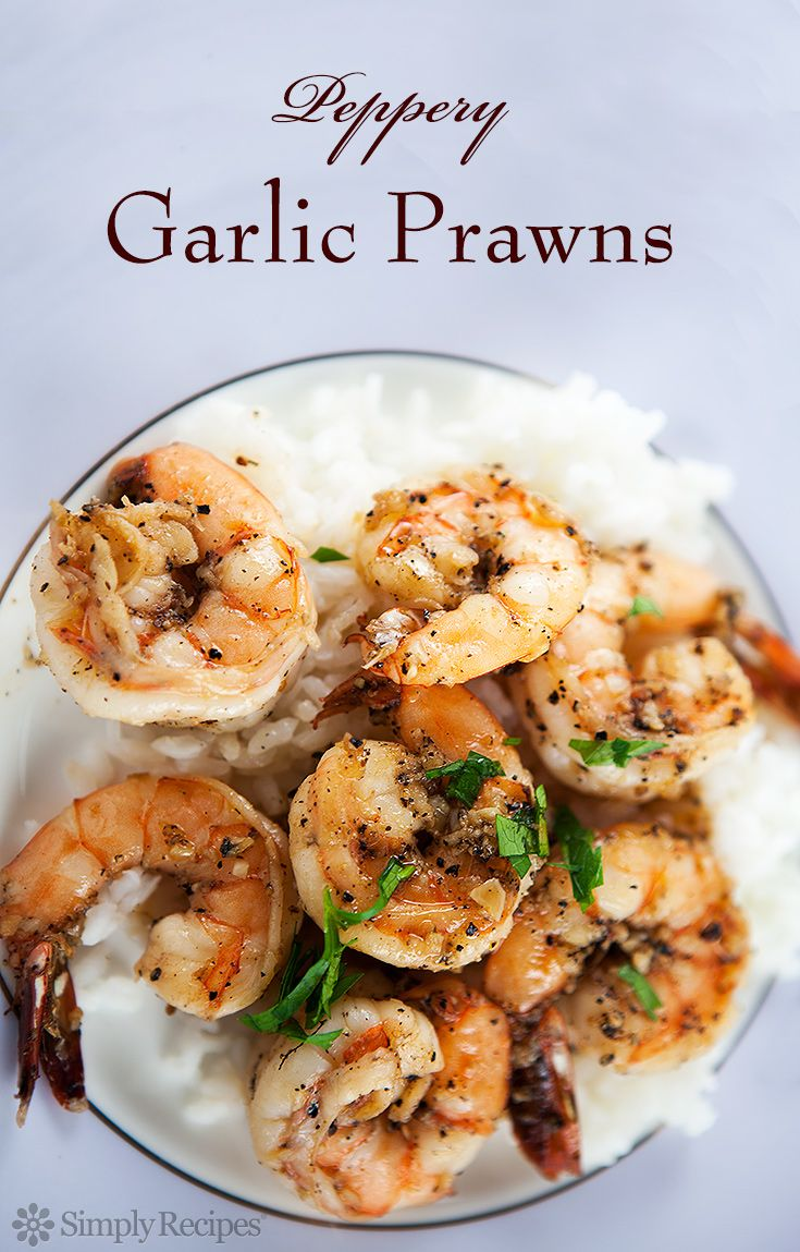 Peppery Garlic Prawns ~ Shrimp marinated in a mixture of garlic, pepper, lemon juice, and brandy, quickly sautéed and served over rice with a sprinkling of parsley. ~ SimplyRecipes.com