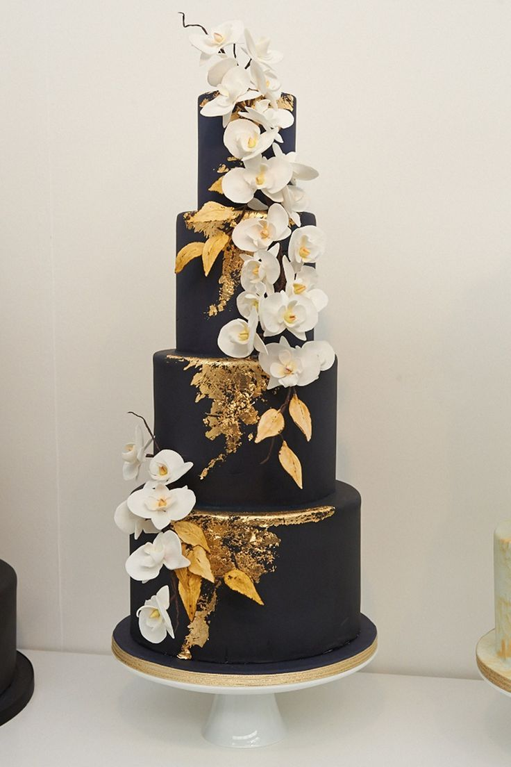 Black Wedding Cake -Black Is The New… Black! Move over trad white tiers - this year it's all about chic black cakes with contrasting gold and floral details.