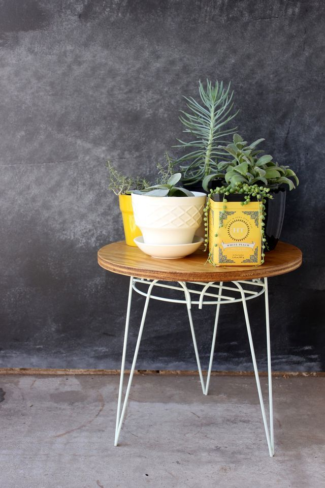 Repurposed Plant Stand End Table ~ I actually did this 3 yrs ago but cut the wood to fit in the plant holder and they are prefect for tables by the fire pit.