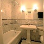 Traditional bathroom with dot accent tile.