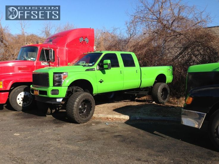 lifted Ford Super Duty trucks, parking were they want since the beginning...Got A Have It Green!