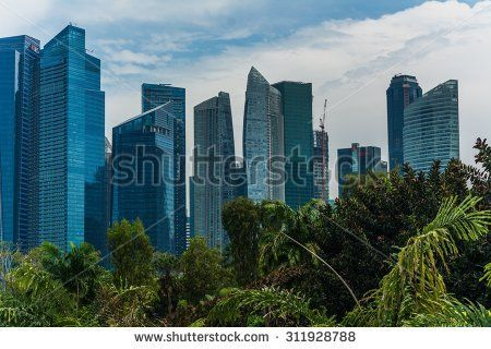 SINGAPORE, SINGAPORE Circa June 2014: the skyline of singapore with the gardens by the bay