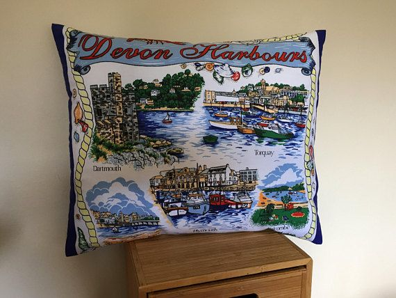 Up-cycled from a new souvenir tea towel made from 100% cotton. This Devon souvenir cushion would be a great reminder of English seaside holidays. Perfect for a beach house styled home, beach hut, boat or caravan. It would also be a useful addition when going on a picnic, for that bit of extra comfort. The cushions include custom made polyester filled insert It measures 17 by 14 (43cms by 36cms) Very occasional hand wash only is recommended. They can be ironed on a hot setting. **All my c...