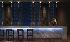 www.limedeco.gr modern wine bar with blue lights and a beautiful marble bar
