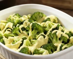 Classic Cheddar Cheese Sauce with Bechamel Base: Cheddar cheese sauce on broccoli
