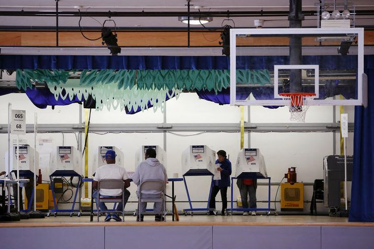 Voters use booths located on the stage at the polling center at the James Weldon Johnson Community Center during the New York primary elections in East Harlem, New York City, April 19, 2016. (Photo by Andrew Kelly/Reuters)