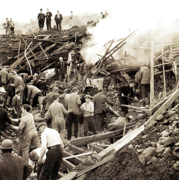 Rescue workers tear into the mud and rubble covering the ruins of houses which together with Pantglas School, were engulfed by mountains of coal slurry at Aberfan near Merthyr Tydfil, Glamorganshire, Wales. 144 people including 116 children, were killed in the disaster - UK - 21 October 1966
