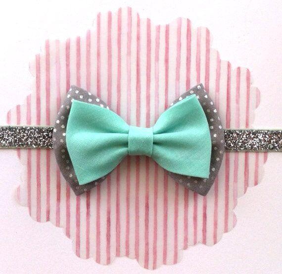 Baby Bow Headband- Silver Dot and Mint Bow on Silver Sparkle Elastic- Glitter Elastic Headband- Seafoam Green Bow. $8.00, via Etsy.