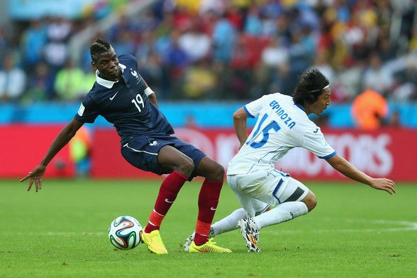 Paul Pogba of France and Roger Espinoza of Honduras battle for the ball during the 2014 FIFA World Cup Brazil Group E match between France and Honduras at Estadio Beira-Rio on June 15, 2014 in Porto Alegre, Brazil.