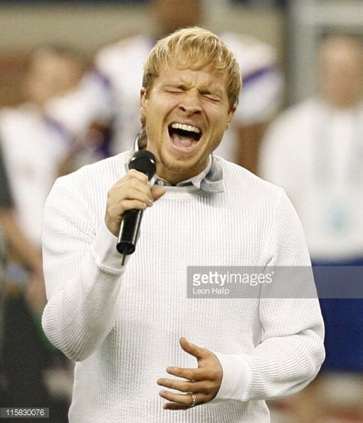 Brian Littrell from the Backstreet Boys sings the national anthem prior to the start of the game between the Minnesota Vikings and the Detroit Lions...