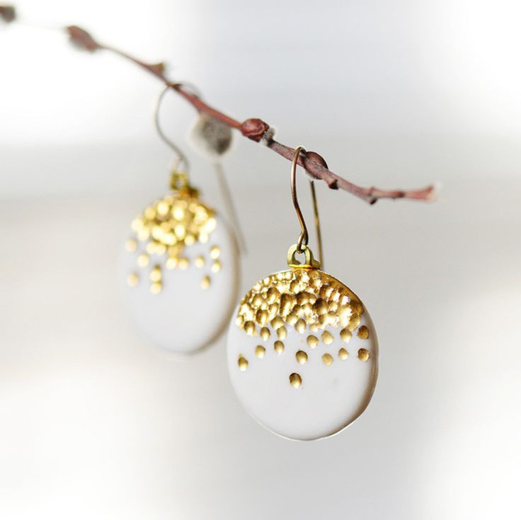 Round porcelain pendant earrings with carved and highlighted 22k gold detailing. These sweet earrings dangle from fine, 14k rolled gold french-hook wires. Inspired by celebration fireworks when the cl