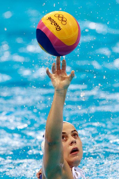 Mariana Duarte Photos Photos - Mariana Duarte #11 of Brazil balances the ball during the Women's Water Polo 7th - 8th Classification match between Brazil and China on Day 14 of the Rio 2016 Olympic Games at the Olympic Aquatics Stadium on August 19, 2016 in Rio de Janeiro, Brazil. - Water Polo - Olympics: Day 14