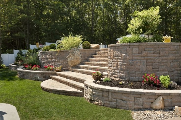 A series of retaining walls and steps using Techo Bloc Quarry Stone as part of the back yard landscaping. www.landscapeplusllc.com