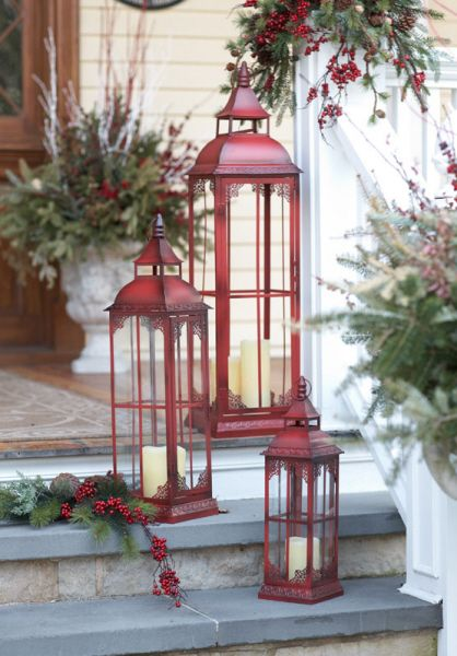 Make a holiday statement with this trio of rustic red lanterns...perfect for indoors or out.