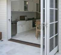 Indoor/outdoor access is made all-too-easy with bi-fold doors. www.brindabellahomeimprovements.com.au