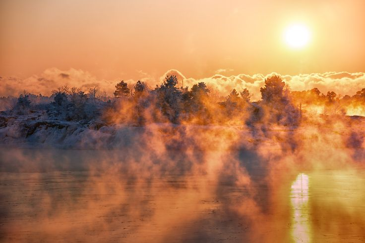 Sea Magic - There is a time window of few weeks in which the sea starts to freeze in this corner of the world. When the cold air rushes above the much warmer water there is a phenomenon called arctic steam fog.   Shooting the fog I was standing in awe watching the nature do its magic.   Soon I'll be able to walk onto the frozen sea to the small island you see  in the frame.