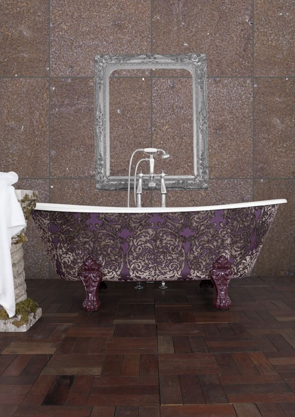 Our #CastIron Schooner bath clad in Amethyst fabric. While fabric cladding on a #bath is not usually done - all of our wrapped baths are treated so no water damage can come to the exterior of the bath! #Bathroom #BathroomInterior #CastIronBaths