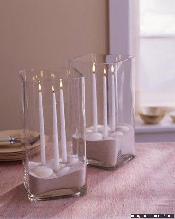 Light up a table with this arrangement perfect for a seaside shower. Use candle adhesive to secure slender tapers to the bottom of a clear glass vase. Carefully pour in a few inches of sand, then arrange shells on top. Besides refracting the candlelight for added ambience, the vase will protect the flames from breeze.