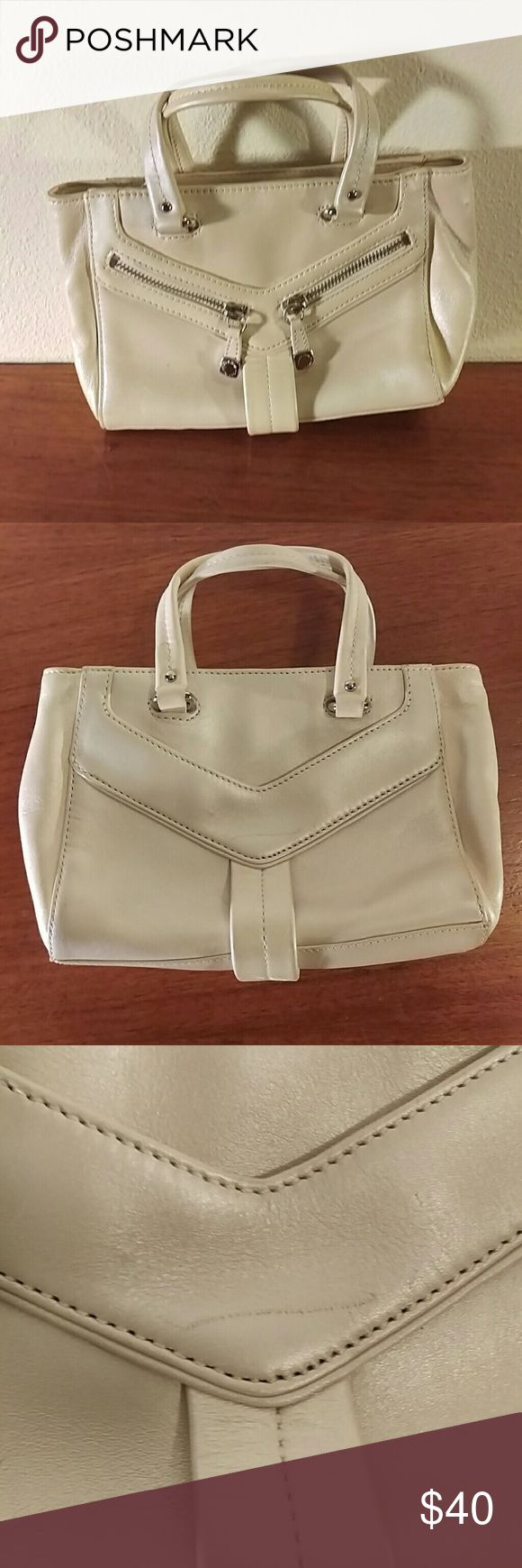 Cole Haan Cream Purse Good condition though has a couple scratches and the form is a little off from being stored for a while. Cole Haan Bags Shoulder Bags