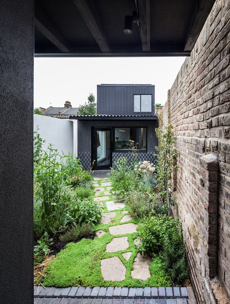 This two-bedroom house within the walls of an infill site in East London relies of a series of courtyards as its main source of sunlight.