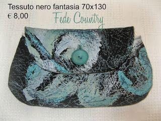 Tessuto nero fantasia come quello della pochette 70x130    €   8