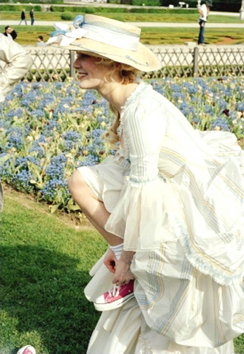 Kirsten Dunst on the set of Marie Antoinette - one of my favourite films - and the costumes have a lot to do with that!