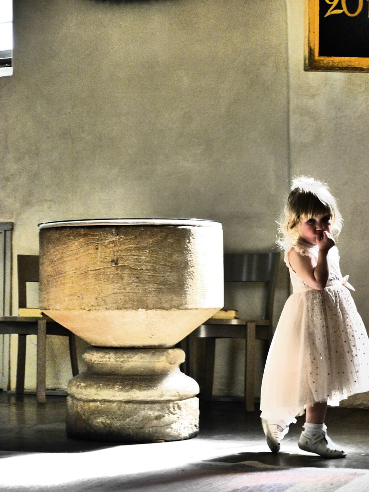 The little bridesmaid and the baptismal font