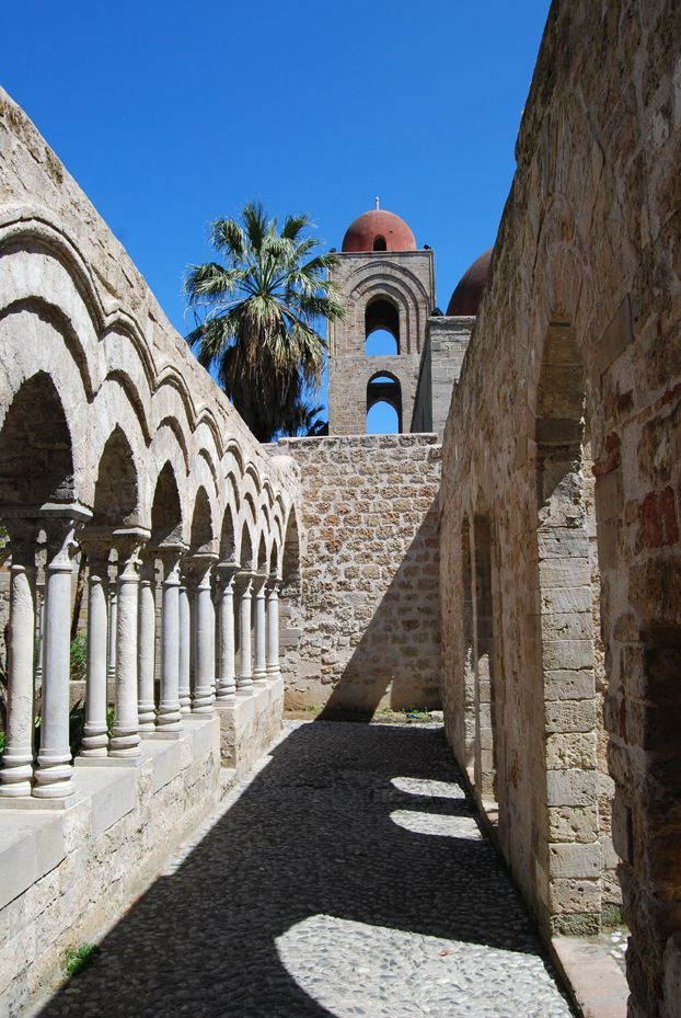 Palermo. Cloister of San Giovanni degli Eremiti. The church's origins date to the 6th century. After the Islamic conquest of Sicily, it was converted into a mosque. After the establishment of the Norman domination of southern Italy, it was returned to the Christians by Roger II of Sicily in 1136,