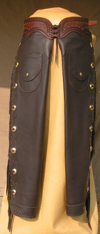 This handsome pair of shotgun chaps feature supple lighter weight, full grain leather, brass hardware, full spotwork, Border stamped belt, two pockets, hand-cut fringe and full zipper legs. Great looking and fitting pair of shotgun chaps. Price includes shipping $650