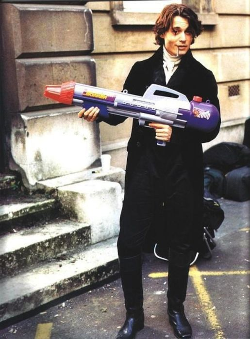 """Johnny Depp smoking a blunt and holding a super-soaker on the set of """"Sleepy Hollow"""""""