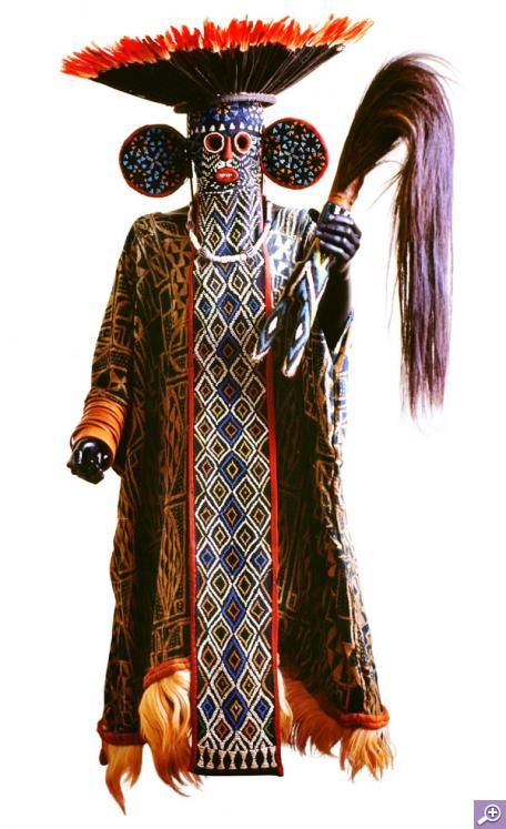 Africa | Kuosi (Elephant Mask) Society Costume. Cameroon | Fabric, fur, hair, beads, ivory, feathers, twine | Full costume consists of a full length tunic, long mask, wide headdress and fly whisk.
