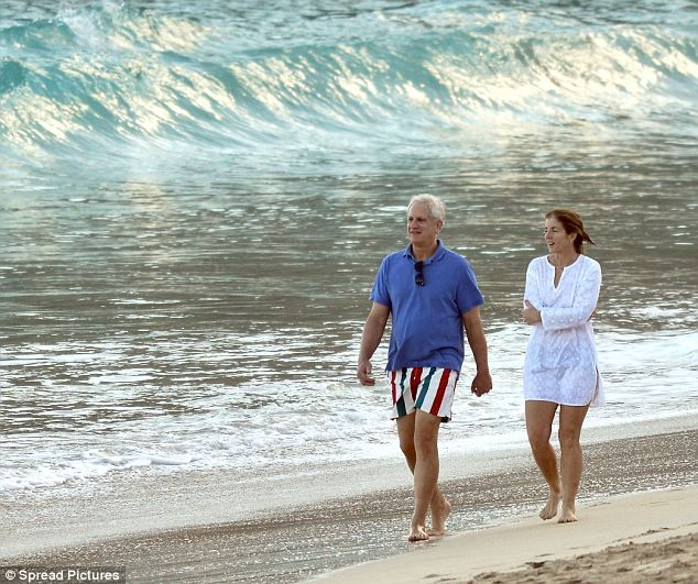 Caroline Kennedy and husband Edwin Schlossberg take a relaxing stroll along the sea front, 03/18/13, on St. Barts, a French Carribean island. They married in 1986.