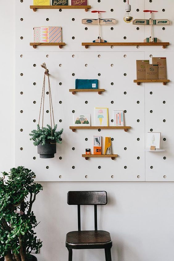 White pegboard with ledges.