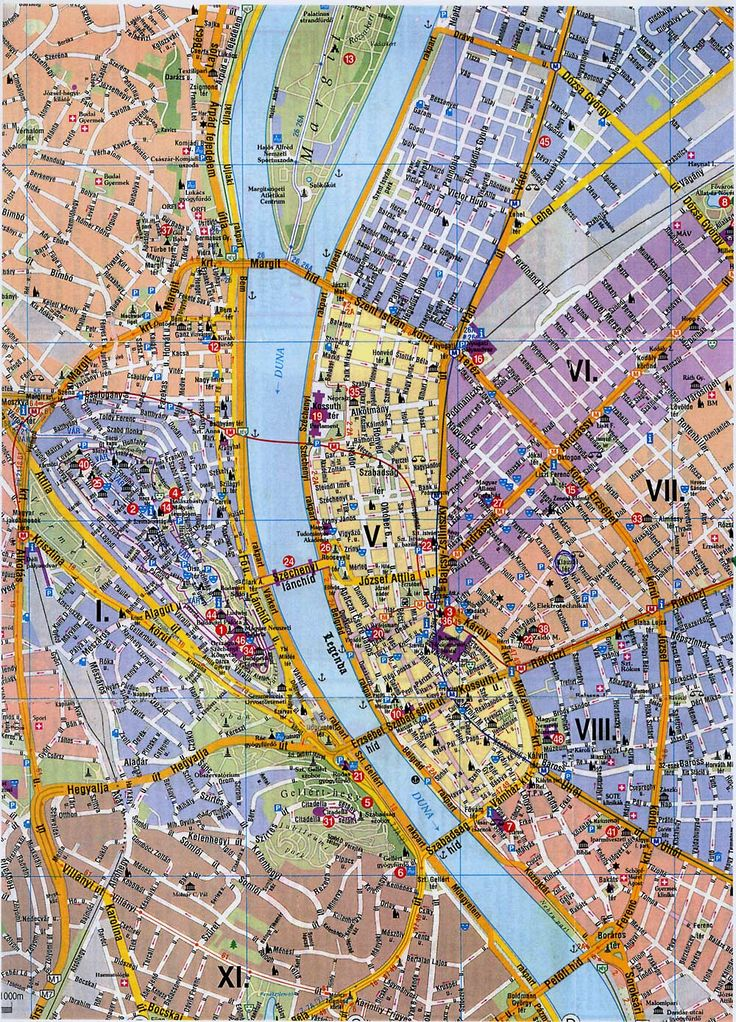 """Tourist Map of Budapest, Buda left, Danube middle, Pest right. Note bridge linked to an island (Margaret bridge/island) at top? The """"great ring road"""" or körút leads from there all the way round to Petöfi bridge in the south. There is also a little ring road inside it that bounds the 5th district. Each administrational district of the city is has a different colour here. Budapest has 23 districts in all, with far more in Pest than Buda, so you can see this is really just the downtown area."""