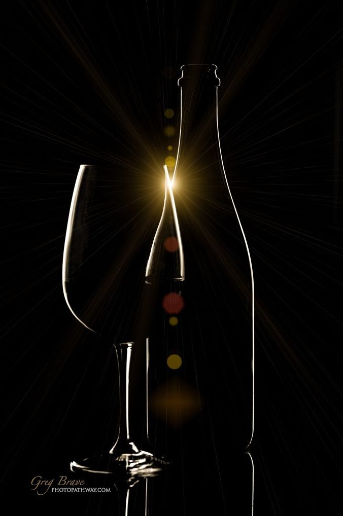 Red wine bottle and wine glass on black background (Wine Bottle Photography)