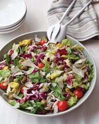 Big Italian Salad Recipe from Food & Wine. Healthy and Delicious: Part green salad, part antipasto salad, this recipe combines lettuce, celery, onion, peperoncini, olives and cherry tomatoes—all tossed in a dressing made with olive oil, vinegar and a little mayonnaise.