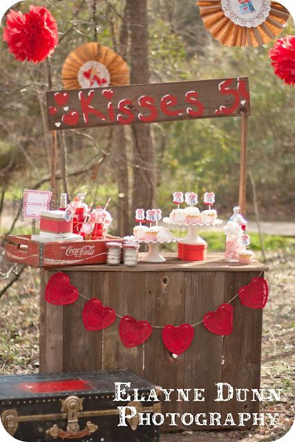 Kissing booth set up for photo op of bride & groom as well as wedding party and guests :0)