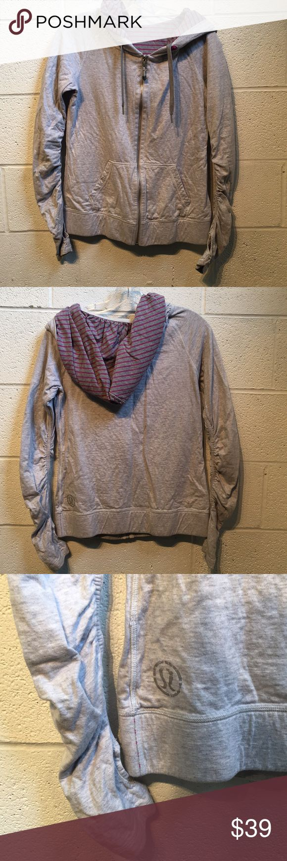 Lululemon grey zip up hoodie size 8. 57723 Lululemon grey zip up hoodie with pockets, purple and grey striped interior and ruched sleeves. Size 8. Excellent used condition, 57723 lululemon athletica Jackets & Coats