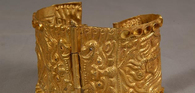 One of the riches found at Khara Khorum, this gold alloy bracelet dates from the 14th century. It is decorated with a phoenix flanked by demons. (Courtesy of the Institute of Archaeology of the Mongolian Academy of Sciences)