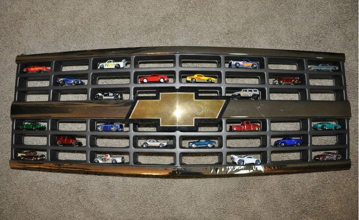 Displaying Hot Wheels in a Chevy grille. Perfect! A cool place for all things miniture!