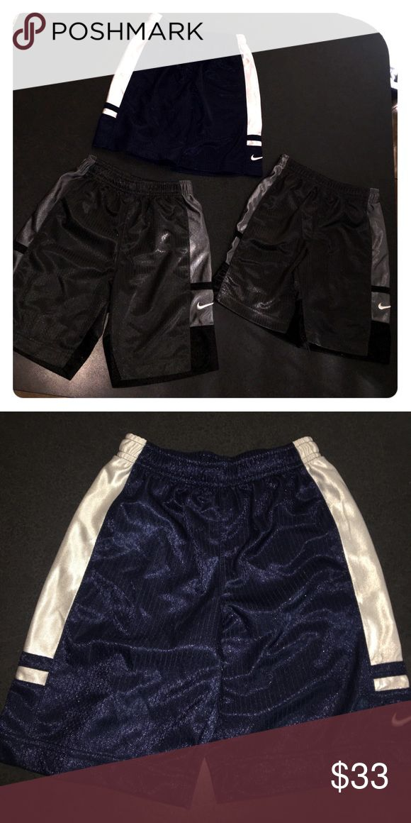 Three pairs of boys Nike shorts. Three pairs of boys Nike shorts. All three size 5T. Two pairs gray and one pair navy blue. All three in brand new condition. Nike Bottoms Shorts