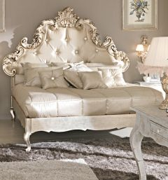 Paris Collection Rococo crystal buttoned silk bed shown here in ivory silk with a champagne silver leaf detailed frame. Carved from walnut. Made to a very high standard. Height 163cm. Alternative fabrics, customers own fabric, frame colours and finishes available.