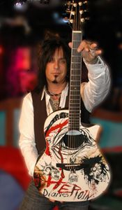 Nikki Sixx holding the Heroin Diaries Guitar <3